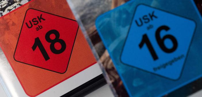 Zwei Games-Packungen mit dem USK-Logo, ab 18 und ab 16. Bild: picture alliance / dpa Themendienst | Andrea Warnecke